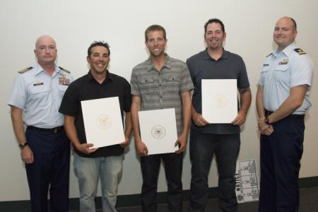 Coast Guard recognizes rescuers of three from capsized boat