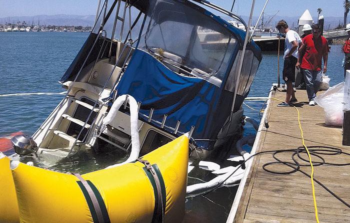 Boat Hits Breakwater, Then Sinks at County Dock