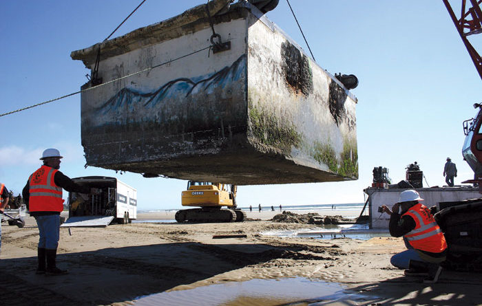 Team Removes Japanese Dock from Beach