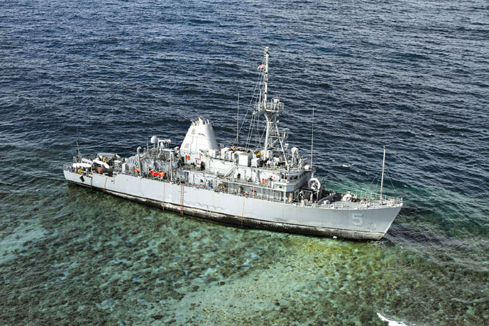 Navy Ship Hits Reef; Declared a Complete Loss