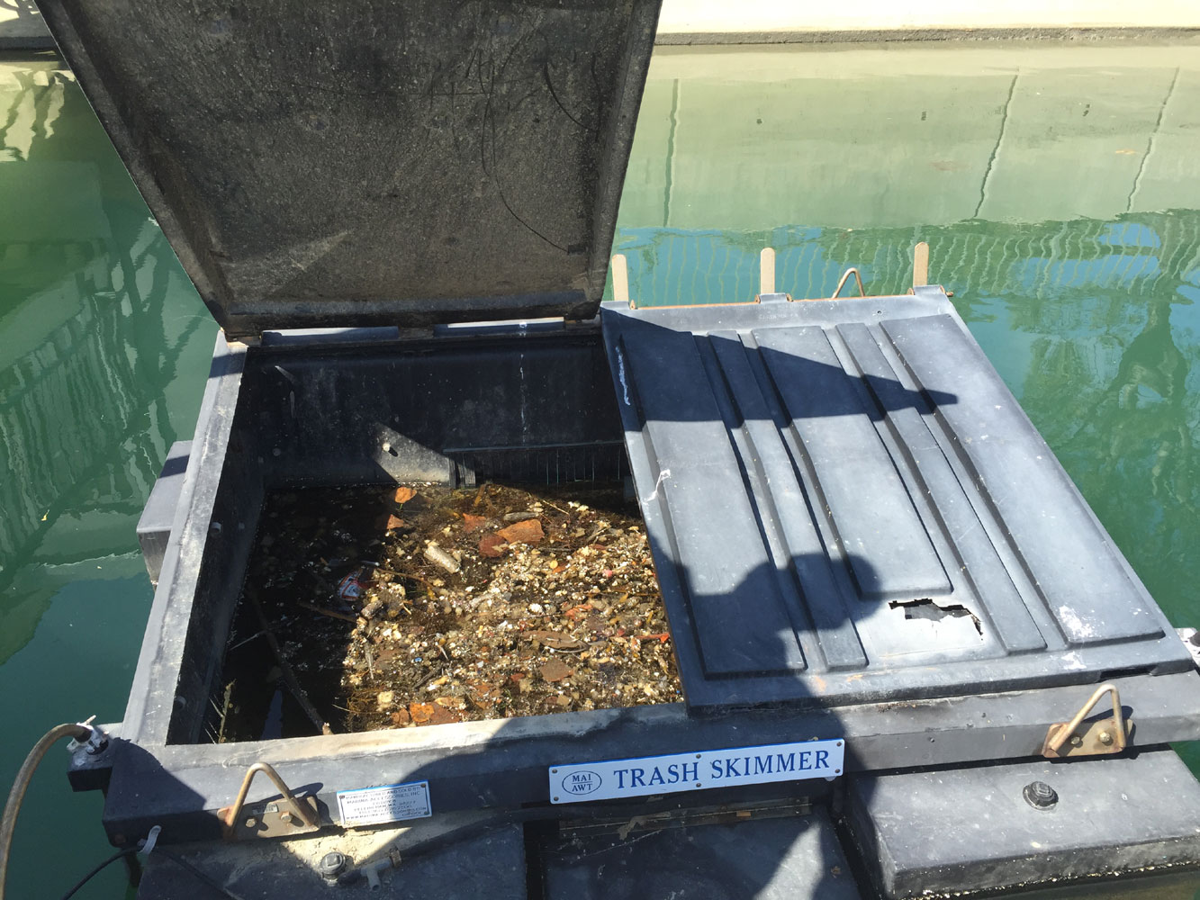 Trash skimmers in Dana Point, San Diego keep harbor waters clean