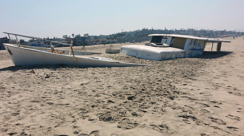 City and county officials to pay $227,500 to remove beached boat