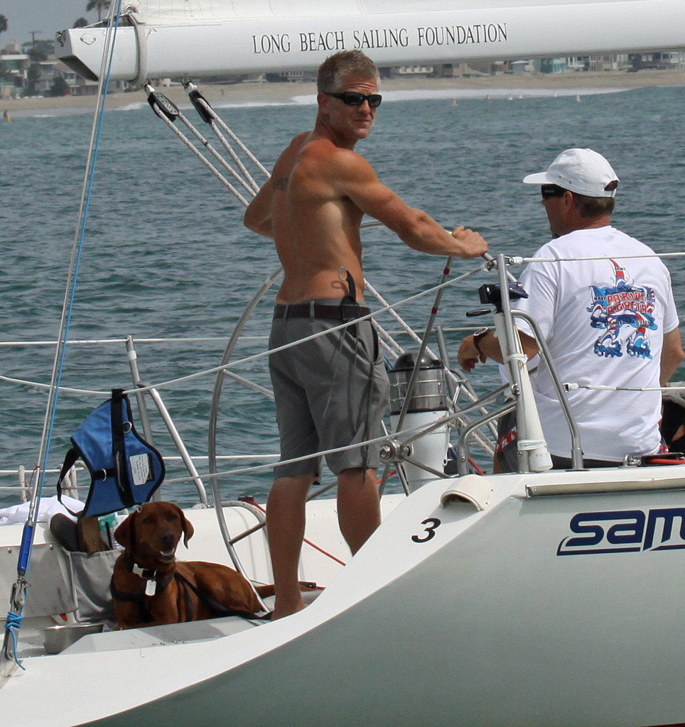 U.S. Army National Guard team member Ryan Healy at the helm with his service dog J.J. during the regatta.