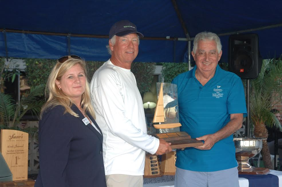 Wani Racing Skipper, Ben Mitchell, and crew with Southwestern Yacht Club Commodore Mary Haller.