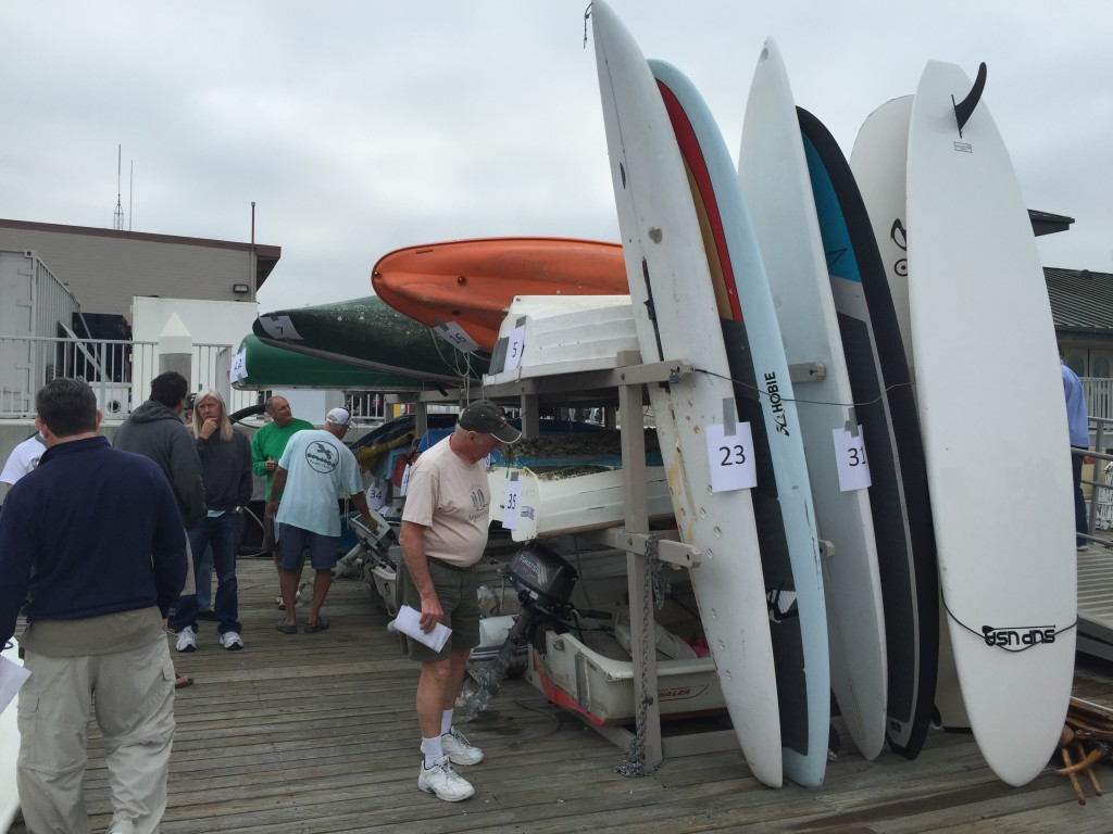 Potential buyers examine boats up for bid at the city of Newport Beachs March 18 boat auction. Parimal M. Rohit photo.