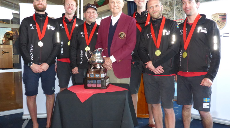 Johnie Berntsson accepts the Ficker Cup trophy from the race's namesake, Bill Ficker. Courtesy photo