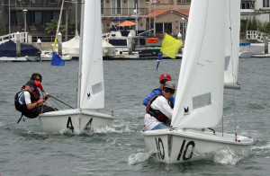 Pictured left to right: Santa Barbara Yacht Club team members David Eastwood and Christopher Kayda chase San Diego YC team members Jack Reiter and Jack Egan during a critical race in the 2016 Long Beach Yacht Club Junior Match Race Invitational.Rick Roberts photo