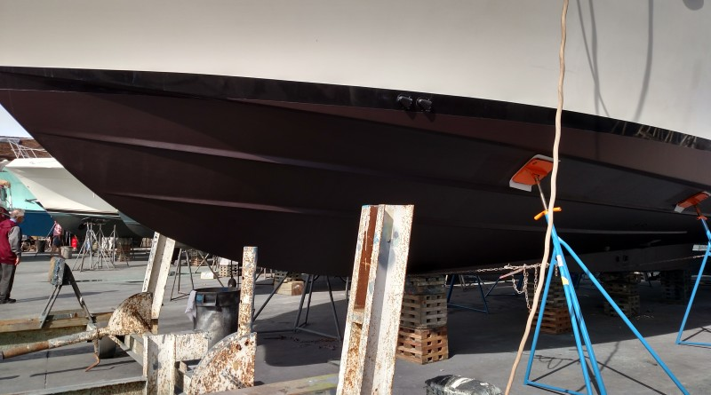 Burgundy sits on blocks at the boatyard, showing off her freshly painted bottom.Capt. Nicole Sours Larson