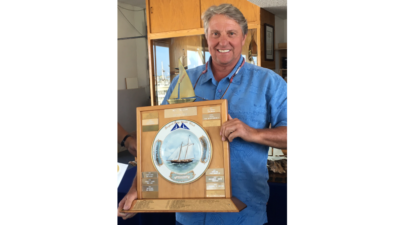 Larry Spencer, skipper of the Olson 30 Blue Star, held the perpetual trophy for the PHRF boat with the lowest corrected time in the 42-nautical-mile Milt Ingram Trophy Race. The trophy was donated by Milt's daughter Blanche and depicts the famous yacht America.