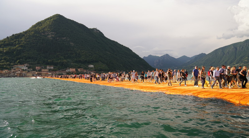 People walk on the 100-by-16 meter sections connecting the island of San Paolo with the island of Monte Isola. The art installation was created by Christo and Jeanne-Claude.Wolfgang Volz