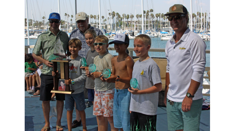 Pictured left to right: Alex Uniack, son of Jessica Uniack; 2016 Jessica Uniack Memorial Beach to Bay perpetual trophy winner, Alex Lech of Long Beach Yacht Club who finished in first place in the biggest class, the Sabot C3s; Bill Uniack, husband of the late Jessica Uniack; Paige O'Dell, Alamitos Bay Yacht Club, second place; Tanner Jolly, Alamitos Bay YC, third place; Hamilton Zahn, LBYC, fourth place; Isaac Sweeney, Seal Beach Yacht Club, fifth place and Long Beach YC Sailing Director Jess Gerry.