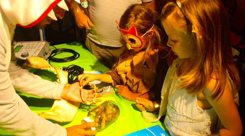 Two little princesses learn about sea creatures during last year's Scripps Institution of Oceanography's Haunted Birch Aquarium Shipwrecked event. This year's celebration takes place Oct. 21-22.