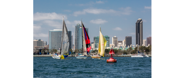 Sailors race in San Diego during the 14th annual Sharp HospiceCare Regatta, which raised $545,000 for hospice patients.